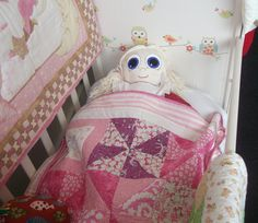 how cute our little rag dolls sleeping with a handmade cot quilt