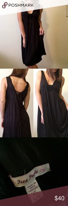 Black Free People Dress Black Free People dress. Size Large. Has detailed trim along the bottom and shoulder line. Plunge neckline and open tied up back. 100% Viscose material. No flaws ! Bundle this item with any other items in my closet for 20% off your total purchase! Free People Dresses Midi