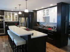Kitchen with two tone cabinets, contrasting quartz countertops