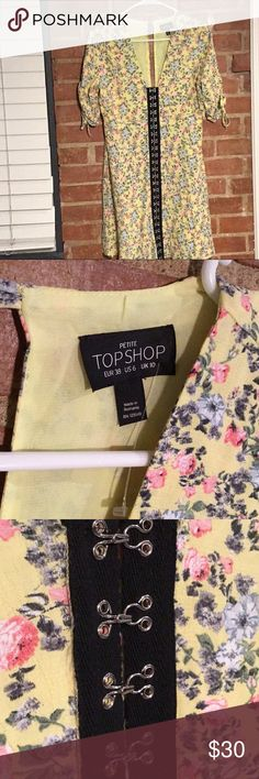 NWOT Topshop Floral Hook & Eye Mini Dress In an inspiring ditsy floral print, this pretty yellow mini dress has a retro vibe. Sitting just above the knee, this classic style has been revamped with edgy hook and eye detailing through the front. Team with sliders and a backpack for weekend fun.100% Viscose. Machine wash. Colour: YELLOW Product Code: 26M45LYLW  Cute Topshop Floral dress for sale This item is new without tags Size 6 Sold out online!!!! Asking price $30  Thanks for sharing 😊…