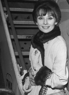 Audrey Hepburn in a fur-trimmed coat and matching hat c. 1962