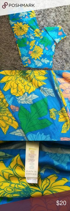 Lularoe TC  floral leggings LulaRoe Tall and Curvy (size fits 12-22) floral leggings with blue background and coral, goldenrod yellow, light blue, mint green and Kelly green flowers/leaves. Buttery soft! Good condition, worn a couple times. Washed per LulaRoe instructions. Some small pilling but nothing too significant when worn. Reposh. These are so pretty but I need to clean out my closet - so.many.leggings. ???? LuLaRoe Pants Leggings