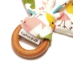 Natural Wooden Teething Ring 'BUNNY' in 'Spring Birds'  fabric and Bamboo Terry....another baby gift idea from Cwtch Bugs. £8.00, via Etsy.