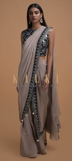 Buy Online from the link below. We ship worldwide (Free Shipping over US$100)  Click Anywhere to Tag Rhino Grey Ready Pleated Saree In Satin Crepe With Jaal Embroidered Navy Blue Blouse Online - Kalki Fashion Rhino grey ready pleated saree in satin crepe with zari, cut dana, sequins and zardozi embroidered border along with coin tassels.Paired with a navy blue blouse in raw silk with embroidered floral jaal.