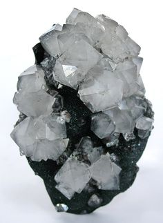 """RHQTZ-101 - Quartz on Hematite - $ 750 SOLD Cleator Moor, Cumberland, England small cabinet, 9.5 x 6.7 x 3.6 cm This is a beautiful curving plate of kidney-ore hematite shell, on which is perched sparkling hematite crystals, on which are perched sharp white crystals of bipyramidal quartz (often called beta quartz from this locality, though it is not tehcnically true """"beta"""" quartz form). From the Schortmann's famous Hotel Lexington exhibitions held in NYC yearly, dated 1950"""
