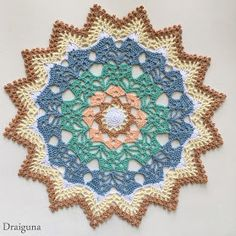 """This doily is 17 rounds and measures about 10 1/2"""".    Materials       size 10 thread in 6 colors, about 100 to 125 yards all together..."""