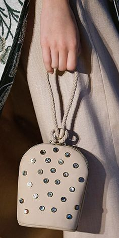 The dome clutch, encrusted with mother-of-pearl embellishments #toryburch #toryburchss16 #nyfw