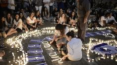 Israelis light candles in Tel Aviv's Rabin Square, as they mourn the killing of three abducted teenagers, Monday, June 30, 2014 (photo credit: Tomer Neuberg/Flash90)