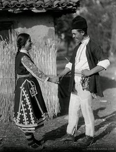 "Young woman and a young man dressed in costumes from Sofia, arranged photograph titled ""Meeting"" 20s of XX century"