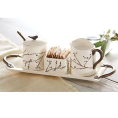 6-piece set. Cream and sugar set features ceramic dimensional twig design on creamer bowl, sugar packet holder and sugar bowl with spoon and lid. Ceramic tray with matte faux-metal finish handles hold