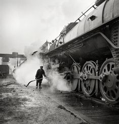 "November 1942. ""Chicago, Illinois. Washing a locomotive at the coaling station at an Illinois Central railyard."" Medium format negative by Jack Delano for the Office of War Information."