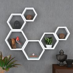 Add a decorative display area to most any room with Set Of 6 Hexagon Wall Shelves