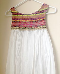 Add a collar/bodice to an outdated skirt for a simple dress refashion.