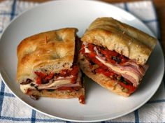 I like to think of the muffaletta as a distant relative of the Italian sub. They both layer on the various meats and cheese—ham, capicola, salami, mortadella, provolone—and rely on something piquant and lively to stand up to all that meat, whether that's hot peppers in an Italian or the famed olive spread of the muffaletta.
