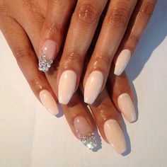 Beige and rhinestone nails