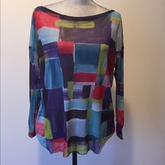 Cute Vibrant Top This is adorable, made out of mesh material, so most likely you would be more comfortable wearing a camisole beneath it. Weston Wear Tops