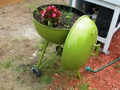 repurposed grill as planter. Love the bright green color and retro look.