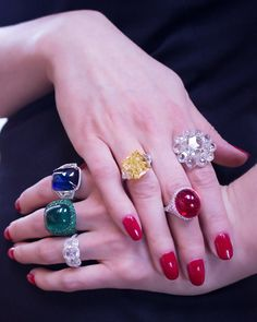 A fine selection of large and important emerald, ruby & sapphire cabochon rings; an impressive rose-cut diamond ring; a 12 carat fancy intense yellow diamond ring; an antique cushion-cut diamond three stone ring