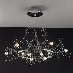 Price: $805.61 Tomia L 2251/10/300 chrome Nature Danika 10-Light Chandelier - Danika Chandelier is unique and desirable for contemporary interiors.