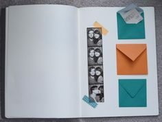 Scrapbook with tiny envelopes.