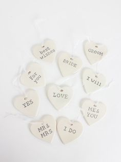 Hanging Hearts – Wedding Phrases Mini ceramic hanging hearts each with marriage phrases- 10 to choose from.   Perfect wedding favours or decorations.