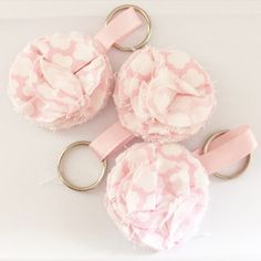 Pink and white mini fabric bloom key chain.