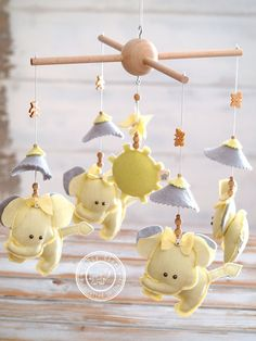 An Elephant #BabyCrib Mobile handmade by #LollyCloth in light yellow and gray shades