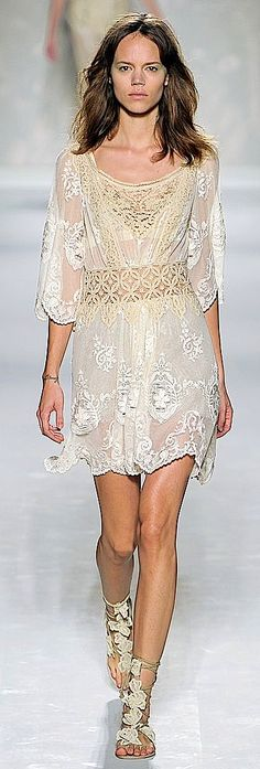 Zuhair Murad;  lovely dress but did someone send this woman on the runway sans make-up on purpose?   How mean spirited!