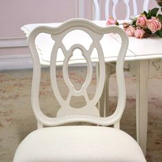 "This gorgeous set of dining chairs features 4 chairs. Each has been newly re-upholstered in our fabulous, cream linen fabric. Each chair has a ornate backing with cut-out detailing. Charming for any shabby chic style home! Features one armchair and three chairs. <BR><BR> Armchair: 23""w x 19""d x 36""t <BR><BR> Chair: 21""w x 19""d x 36""t"