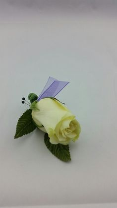 White Rose Boutonniere with Royal Purple and Lavender Accent