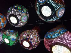 """""""Etsy Find: Gourd Art Lampshades -- We definitely have a soft spot for pendant lighting of all kinds, and these are pleasingly, colorfully, definitely different. The light they cast is soft, more like mood lighting, but would make a beautiful focal point overhead.   These were handmade in Turkey, underscoring the wonder that is Etsy. They remind us a bit of Mexican tin stars, but come off a bit softer."""""""