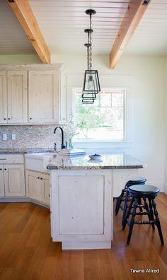 Tawna Allred's modern country kitchen with industrial pendants, painted cabinets, painted tongue and groove ceiling with exposed beams. Floors are quarter-sawn white oak, stained to match the beams.