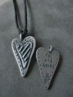 """This unique heart shaped pendant has great depth and design on the front with the words """"You Are Loved"""" on the back. Also a nice way to let those who live far away know that you are thinking of them.     This necklace is very special to me.  One, it is one of magnificant pieces from Sandy Comstock/ Toby and Max.  The second is that my family gave this to me for my birthday this past weekend"""