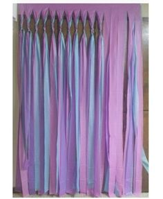Make your own party backdrop. Just cut plastic table cloths and then tie together at the top.