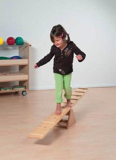 Seesaw Trains concentration and movement coordination. Slots incorporated into the Seesaw help prevent children from … Games For Kids, Diy For Kids, Activities For Kids, Backyard Playground, Backyard Games, Scrap Wood Projects, Woodworking Projects For Kids, Woodworking Toys, Wood Toys
