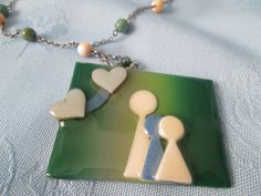 """People Pins by Lucinda -  w/ Three Figures &  Hearts - Collectable - Pendant / with chain - green, blue, cream - Pendant 2"""" -  Chain 23"""" by LsFindsandCreations on Etsy"""