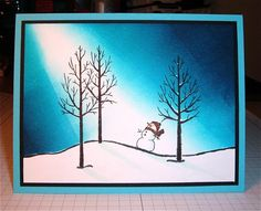 """For this card I stamped the tree/hill image in the center of a 3 3/4 x 5"""" piece of Whisper White, then extended the snowy hill on each side with a fine black pen. I masked off the snow and brayered in the sky, colored in the trees and snowman's scarf/hat, and added shadows with BG10. I also added some snow to the tree branches with a white gel pen. It's hard to see, but I went over the whole snowy hill with Wink of Stella for some subtle sparkle."""