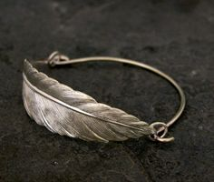 Check out this item in my Etsy shop https://www.etsy.com/listing/99359633/feather-bracelet-bangle-bracelet-silver