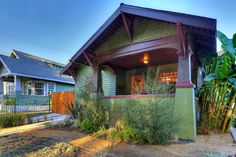 1912 Craftsman style house in Highland Park with original wood siding, exposed rafters, eaves and square columns, 565k