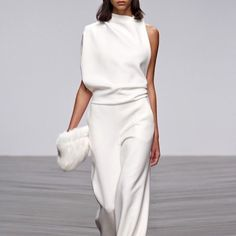 Minimal jumpsuit with a fluffy clutch. A beautiful ensemble #minimal #clutch…