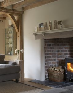 Since 1980 Border Oak have specialised in the design and construction of exceptional bespoke oak framed buildings across the UK and abroad Corner Stone Fireplace, Inglenook Fireplace, Cottage Living, Home Living Room, Barn Living, Country Living, Living Area, Interior Columns, Interior Design