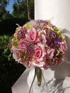 LOVE the idea of having a few super sparkly brooches mixed into everyone's bouquet of real flowers! Need to find some brooches to give my florist~ WEDDING Bouquet, BROOCH, JEWELED Bouquet, Silk Flowers, Bridal, Jewels, Metal Bouquet Holder, Feathers, Satin Roses, Bridesmaids Bouquet. $205.00, via Etsy.