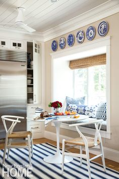 A modern bistro set and a sunny window seat add a splash of fun to the kitchen area.