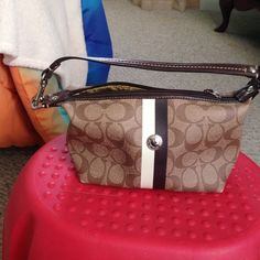 Small brown coach purse In good condition but corners are slightly faded but very minor Coach Bags