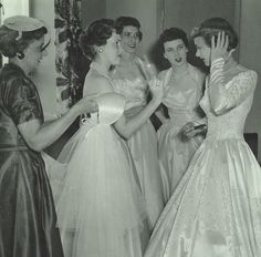 A bride and her attendants getting ready for the big moment, 1954. #vintage #bridge #wedding #bridesmaid #1950s #dress