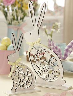 set of two white wood easter bunny ornaments by the contemporary home | notonthehighstreet.com