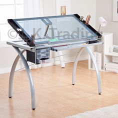 Design/Technical drawing table. Various online for approx £100 (need smaller) RHA design blueprints spread on glass, tip/cards/wipes etc in side slots. POS / Video on top.