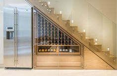 Look at this gorgeous staircase solution... Frameless Glass Balustrade and home winery at the same time...