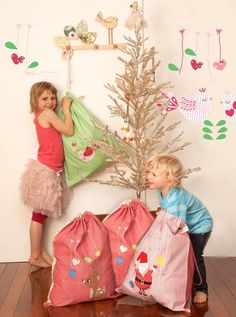 Santa sacks. kids leave out old toys for Santa to take to other kids.-- LOVE this!! What a perfect way to teach giving!