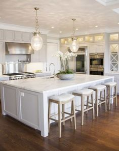 Large Kitchen island with Seating. Large Kitchen island with Seating. Bookend Shelves On A Large Kitchen island with Seating Kitchen Island With Cooktop, White Kitchen Island, Kitchen Island With Seating, Grey Kitchen Cabinets, Kitchen Cabinet Design, Kitchen Designs, Kitchen Interior, New Kitchen, White Kitchens